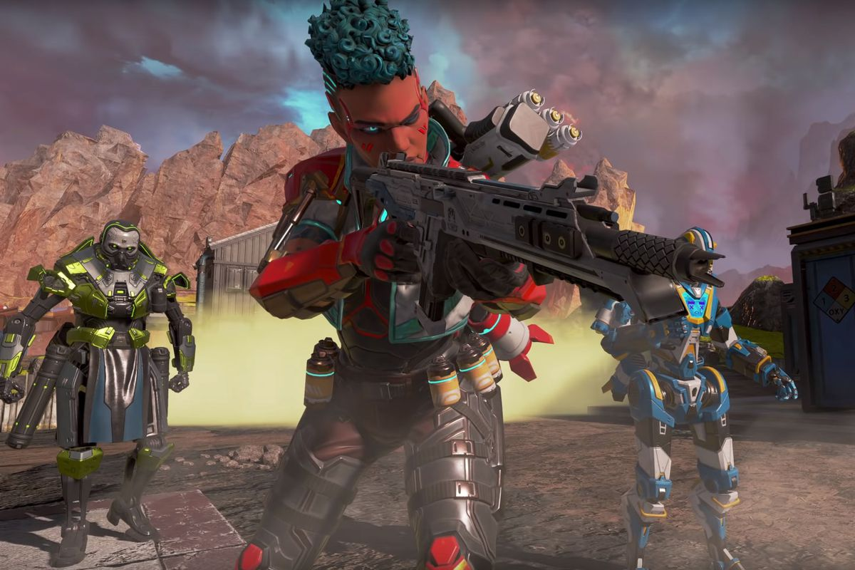 Bangalore in her System Override Collection outfit faces the camera while carrying a big gun in Apex Legends
