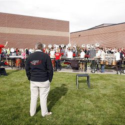 American Fork High Marching Band director John Miller watches the band practice for an upcoming competition and for the funeral of American Fork High band instructor Heather Christensen, who was killed in a bus accident on their way back from a band competition in Idaho over the weekend.
