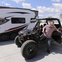 Ryan Frost moves a Polaris RZR so he can load it into the back of histrailer outside of his home in Draper on Thursday, May 21, 2020. Frost is going camping at Palisade State Park in Sanpete County.