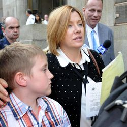 Anna Gristina exits Manhattan criminal court with her son Nicholas in New York on Tuesday, Sept. 25, 2012. The suburban mother of four charged with moonlighting as a multimillion-dollar madam pleaded guilty Tuesday to promoting prostitution. The judge said she'll be sentenced on Nov. 20, 2012 to time served and probation as part of a plea deal.