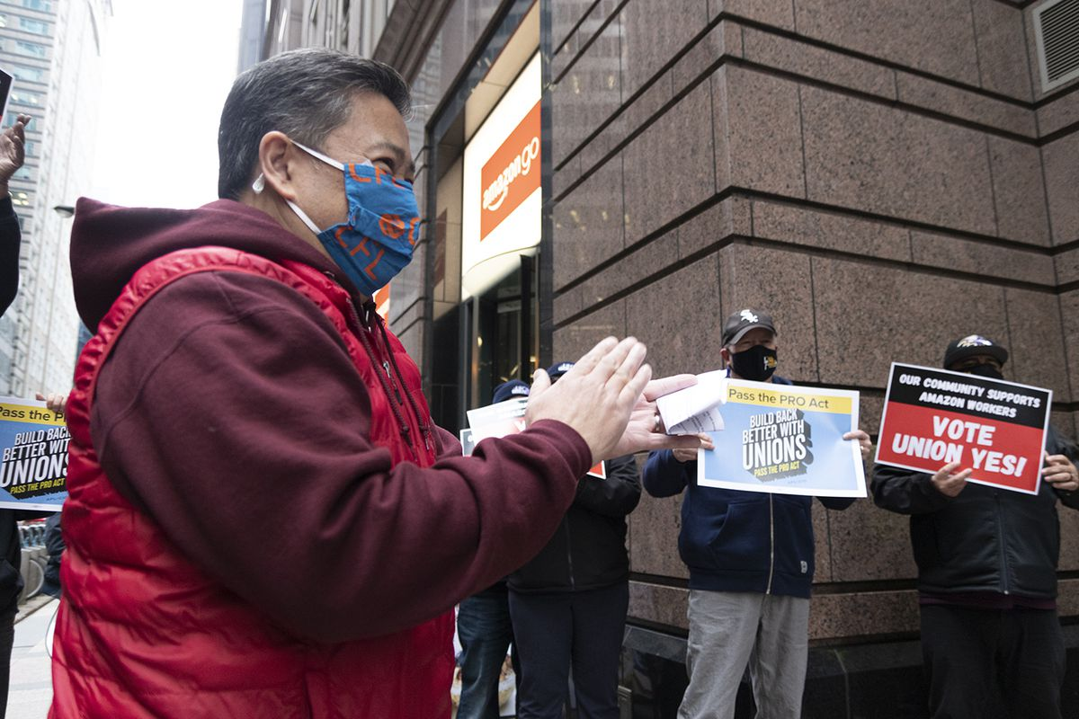Chicago Federation of Labor Secretary-Treasurer Don Villar leads union workers in protest outside of the Chicago Amazon corporate office and Amazon Go store Friday, March 26.