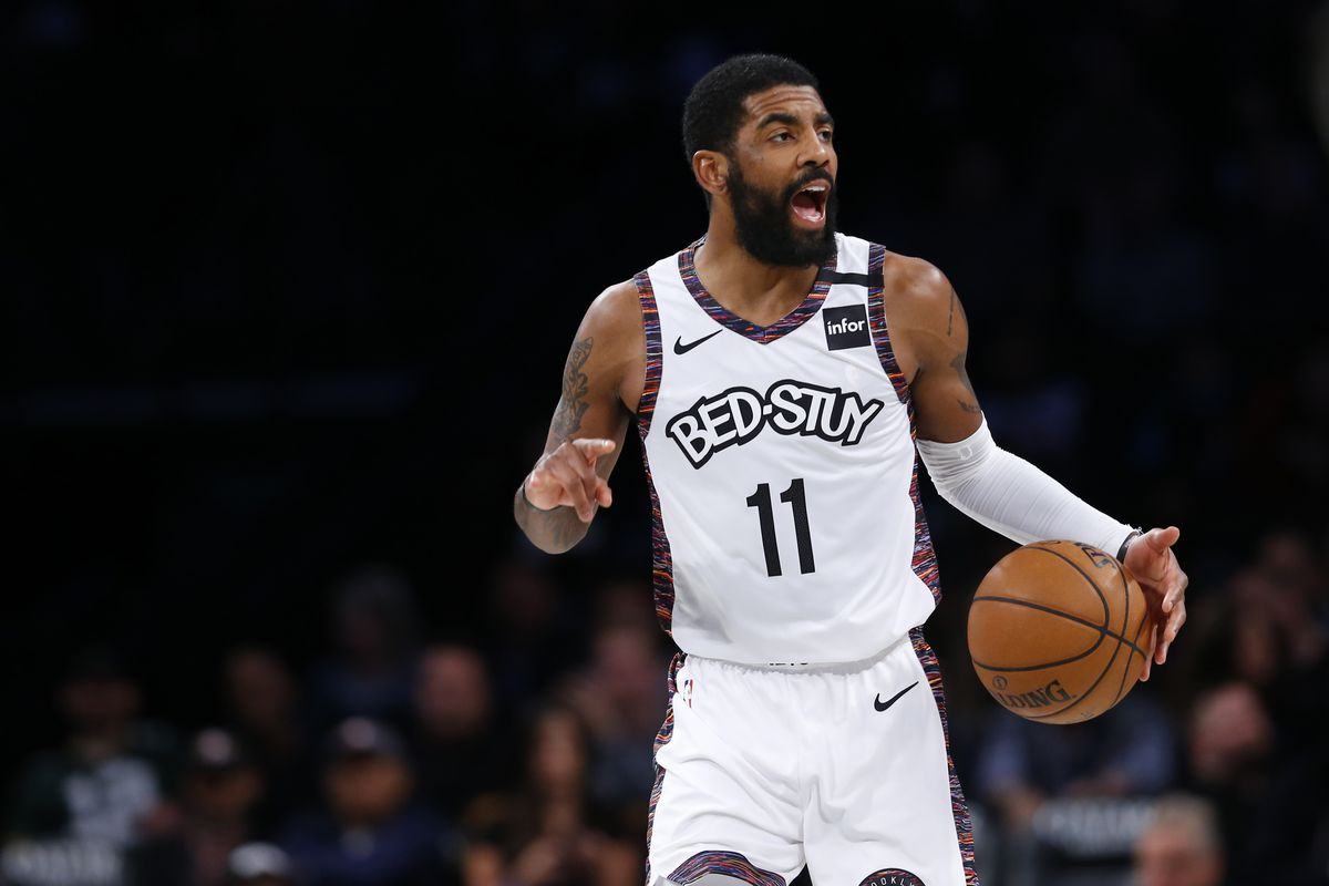 Brooklyn Nets guard Kyrie Irving dribbles the ball against the Milwaukee Bucks during the first half at Barclays Center.