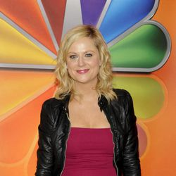 """FILE In this May 14, 2012 file photo, actress Amy Poehler from """"Parks and Recreation"""" arrives for the NBC network upfront presentation at Radio City Music Hall,  in New York. 2012 Emmy nominee Amy Poehler jokingly says that baby aspirin and a small children's pool of sangria helps to combat award show nerves for the veteran actress."""
