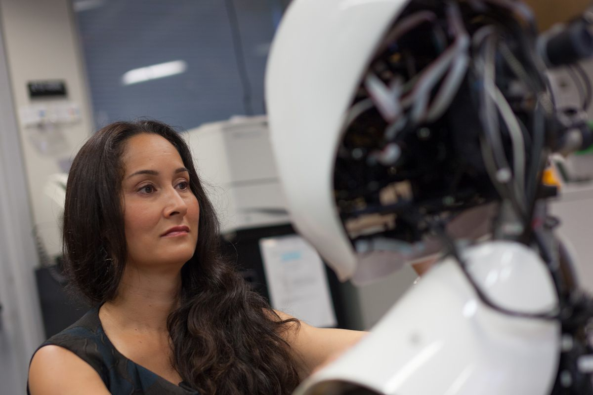 Cynthia Breazeal interacting with a robot at the MIT Media Lab