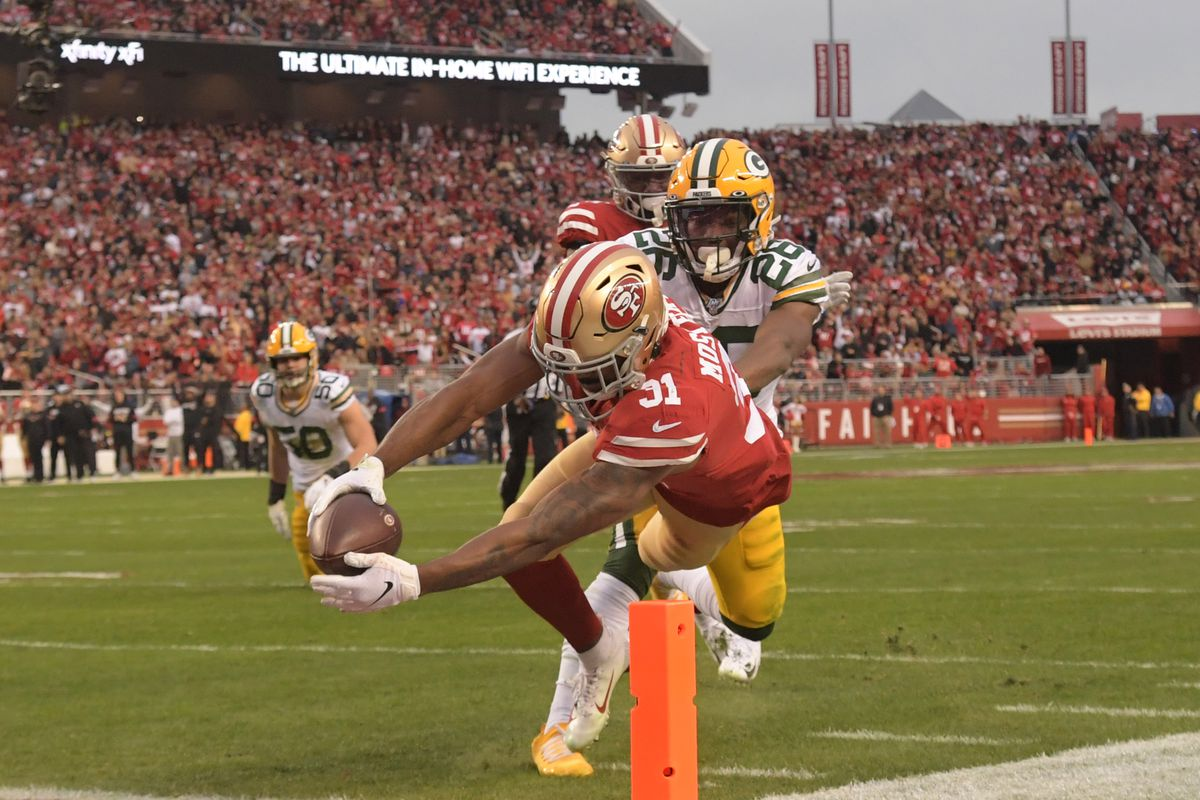 San Francisco 49ers running back Raheem Mostert scores a touchdown past Green Bay Packers free safety Darnell Savage (26) in the second quarter of the NFC Championship Game at Levi's Stadium.