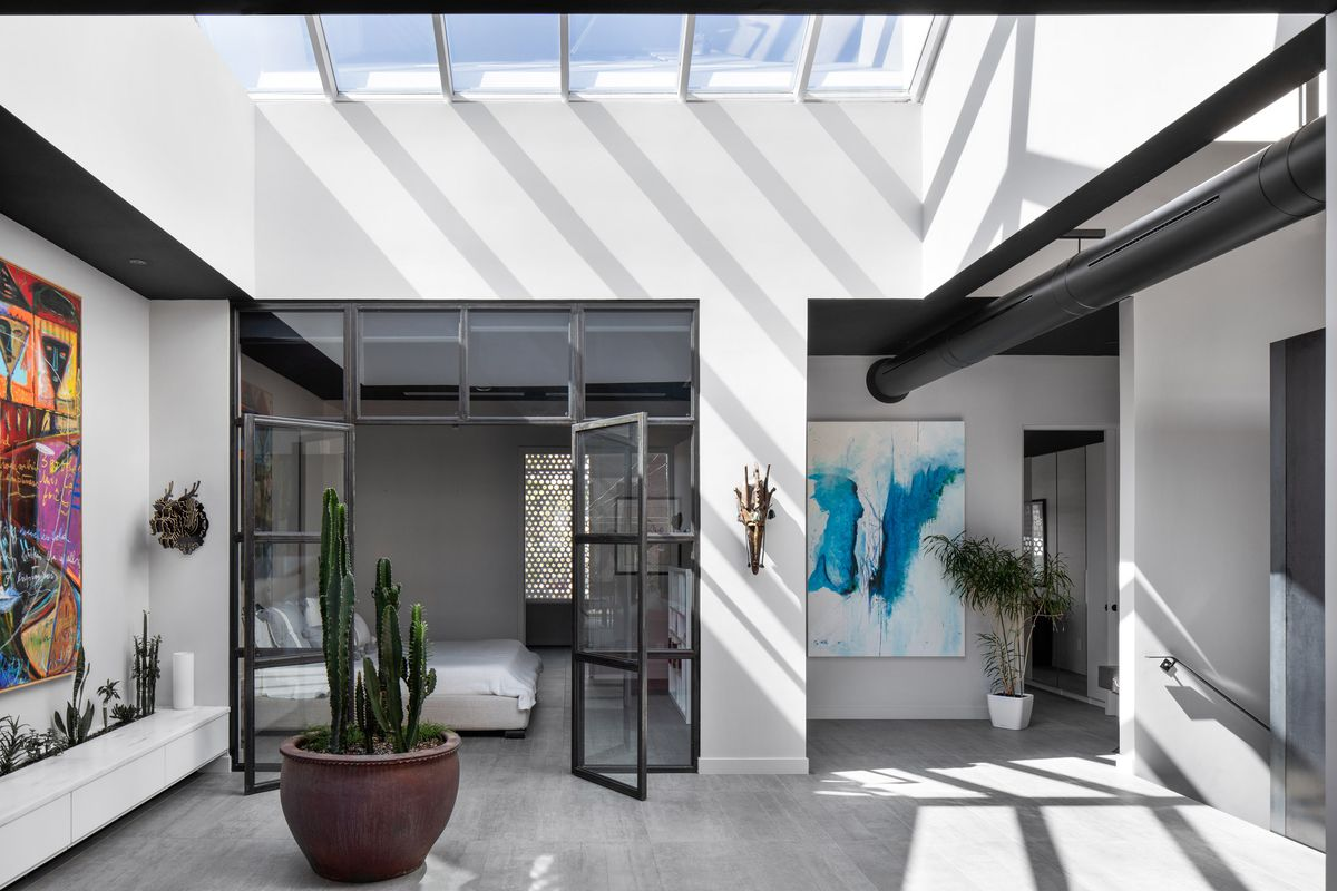 Interior room with skylights and concrete floors.
