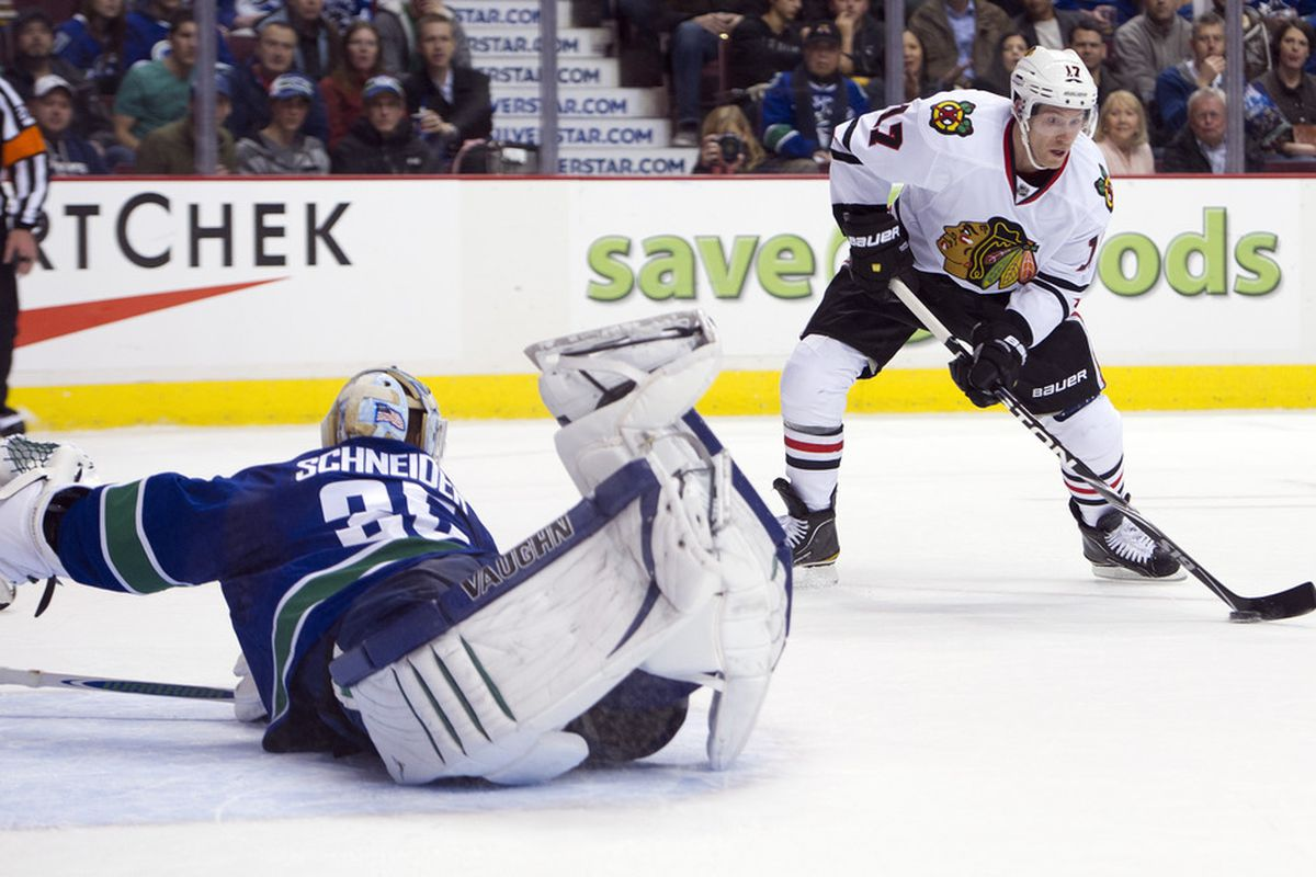 VANCOUVER, CANADA - JANUARY 31: Goalie Cory Schneider #35 of the Vancouver Canucksgivith and taketh away. Yeah, verily, what a save! on January 31, 2012 at Rogers Arena in Vancouver, British Columbia, Canada.  (Photo by Rich Lam/Getty Images)