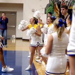Orem's Puka Nacua and the Orem cheerleaders react after Nacua scored in the last seconds of a Vivint Great Western Shootout basketball game against the British Columbia Christian Panthers at Orem High School in Orem on Friday, Dec. 8, 2017. Orem won 63-56.