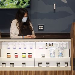 Pharmacist Nadia Lian works at Curaleaf, a cannabis dispensary, in Lehi on Wednesday, Sept. 23, 2020.