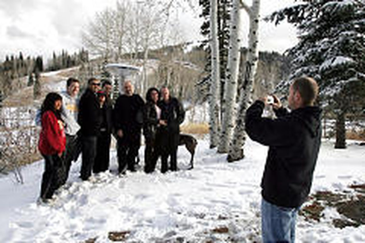 Visitors from Los Angeles gather for a photograph Friday outside Stein Eriksen Lodge at Park City.