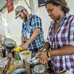 The crew from Virgil Kaine squeeze lemons at the Atlanta Food & Wine Festival tasting tents in Piedmont Park.