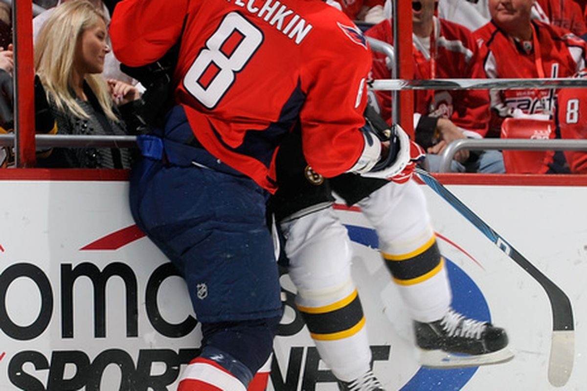 WASHINGTON - OCTOBER 19:  Alex Ovechkin #8 of the Washington Capitals checks Mark Stuart #45 of the Boston Bruins at the Verizon Center on October 19 2010 in Washington DC.  (Photo by Greg Fiume/Getty Images)