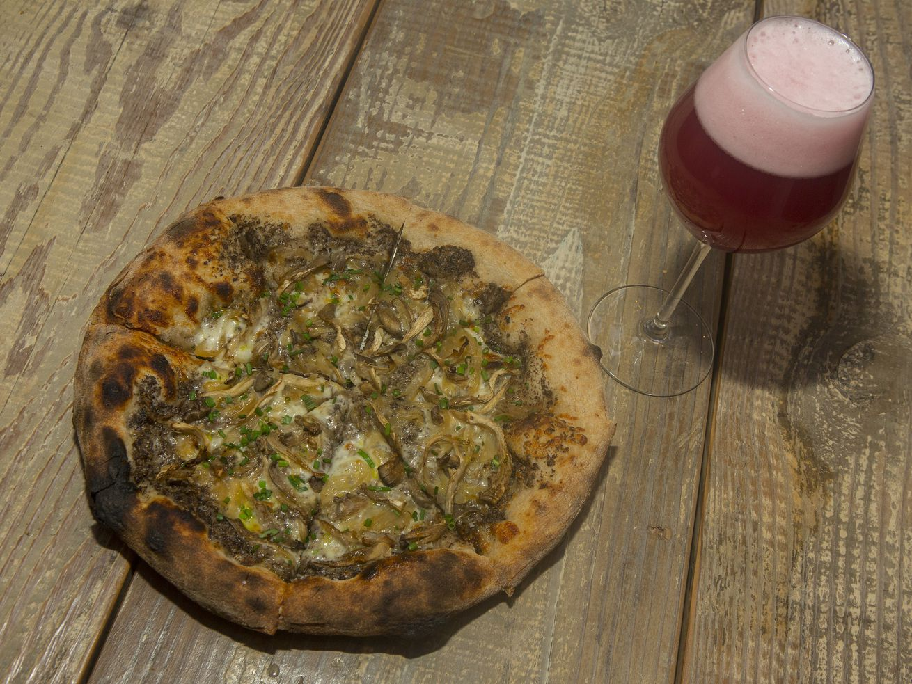 Pizza and beer is an undefeated combo and featured at Middle Brow Beer Bungalow.