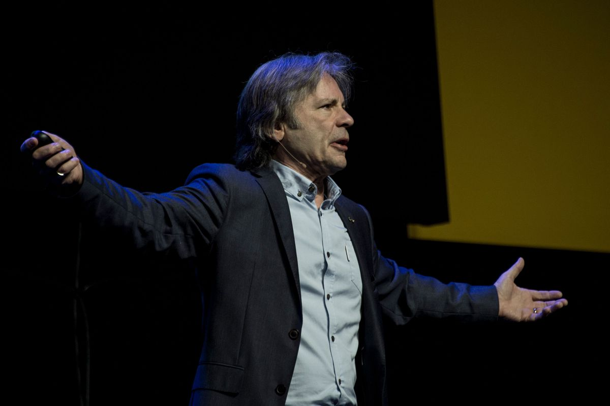 Bruce Dickinson, author, musician and frontman of the hard-rock and heavy-metal band Iron Maiden, speaks during a convention for thousands of young students in Santiago, Chile, in 2018.