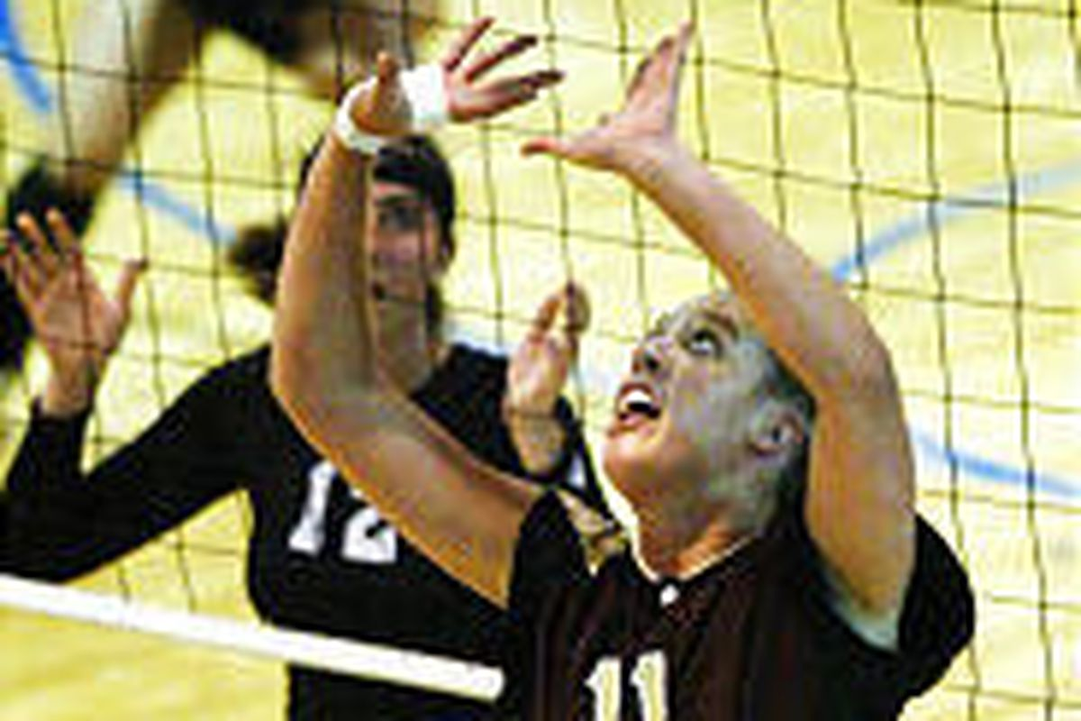 Lone Peak's Ashley Hamilton sets the ball during a match against Pleasant Grove in a losing cause.