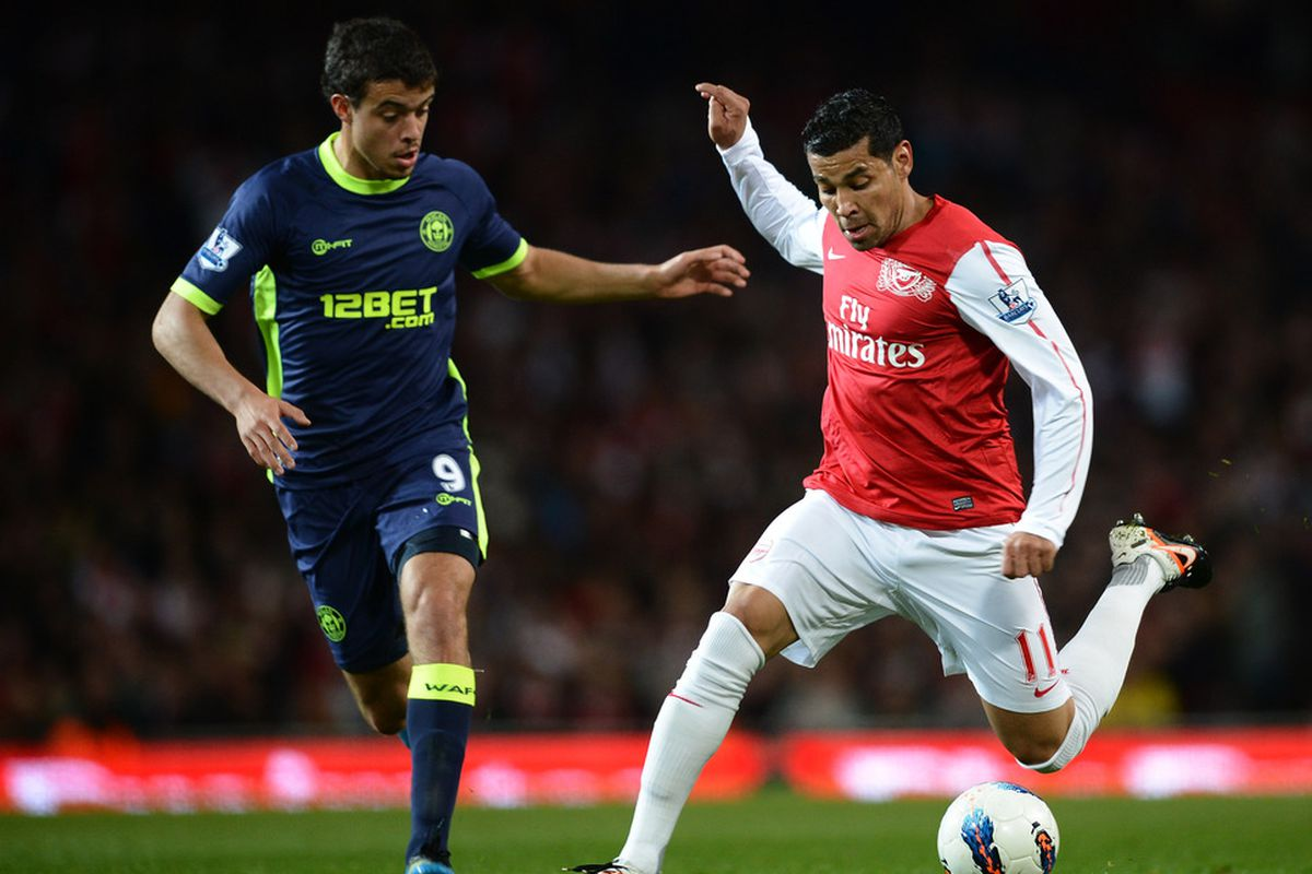 Andre Santos of Arsenal and Franco Di Santo of Wigan battle for the ball during the Barclays Premier League match between Arsenal and Wigan Athletic at Emirates Stadium.