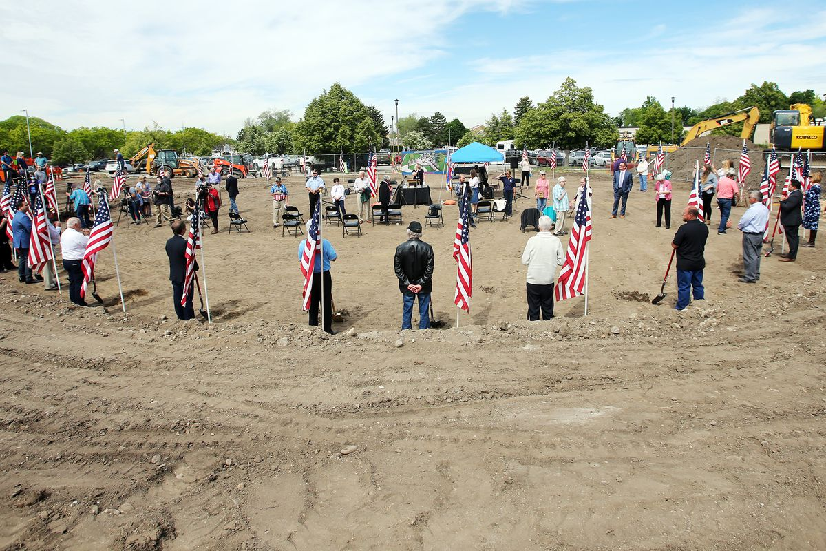 Officials and community members gather at a groundbreaking ceremony for the Bountiful Veterans Parkin Bountiful on Tuesday, May 26, 2020.