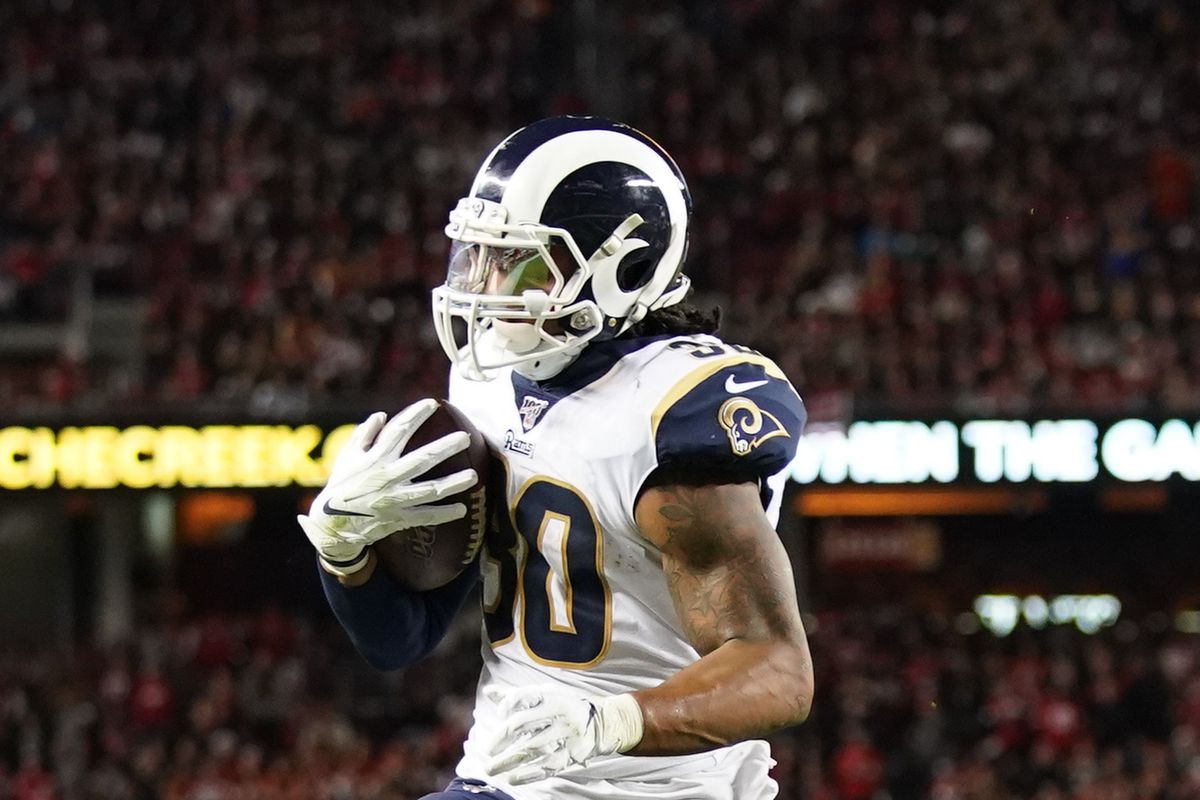 Los Angeles Rams running back Todd Gurley scores a touchdown against San Francisco 49ers defensive end Arik Armstead during the second quarter at Levi's Stadium.
