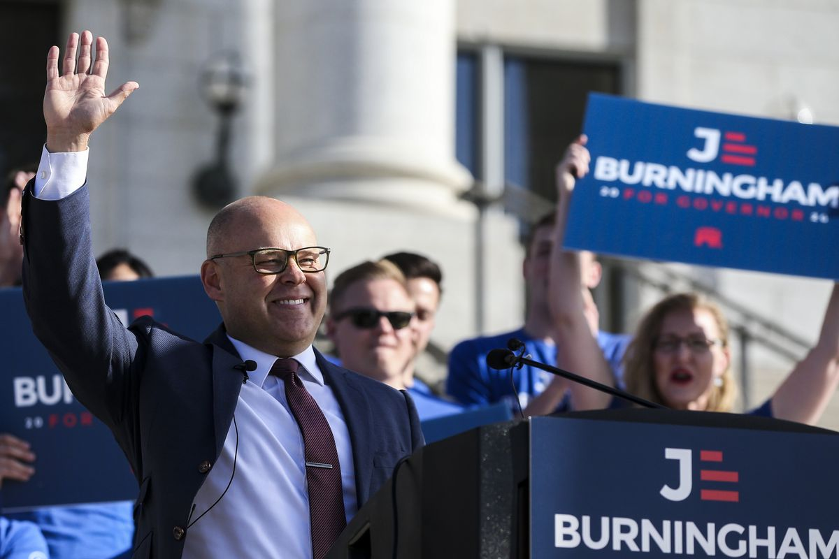 Republican Jeff Burningham waves to the crowd of supporters and media after announcing his candidacy for Utah governor on the steps of the state Capitol in Salt Lake City on Tuesday, Sept. 10, 2019.