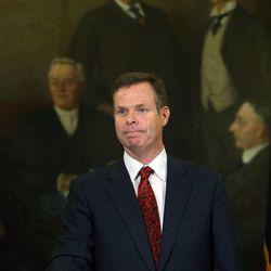 Embattled Utah Attorney General John Swallow announces his resignation at the Capitol in Salt Lake City on Thursday, Nov. 21, 2013.