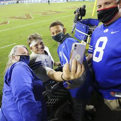 Brigham Young Cougars quarterback Zach Wilson (1) shoots a selfie with fans after the Boca Raton Bowl in Boca Raton, Fla., on Tuesday, Dec. 22, 2020. BYU won 49-23.