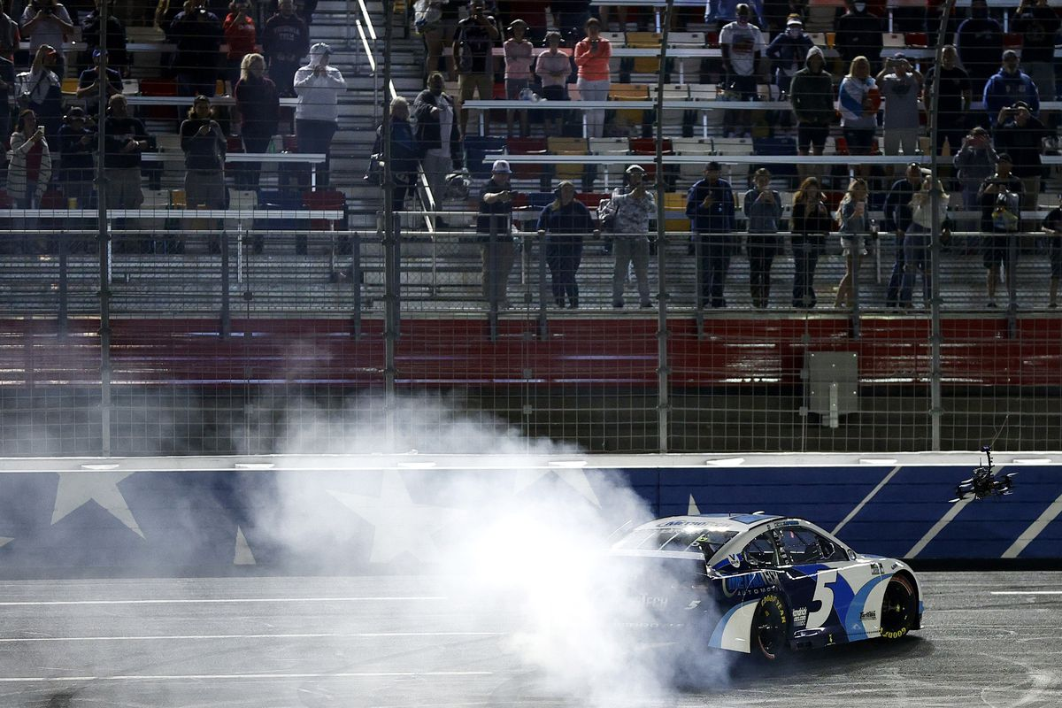 Kyle Larson, driver of the #5 Metro Tech Chevrolet, celebrates with a burnout after winning the NASCAR Cup Series Coca-Cola 600, Hendrick Motorsports' 269th Cup Series win, the most in NASCAR, at Charlotte Motor Speedway on May 30, 2021 in Concord, North Carolina.
