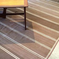 """""""Wood floors aren't the easiest to keep clean and spacious rugs help the cause. I am obsessed with Abbot Kinney's Burning Torch boutique and <A href=""""http://www.burningtorchinc.com/boutique/product.php?productid=792&cat=105&page=1"""">this</a> understated, o"""