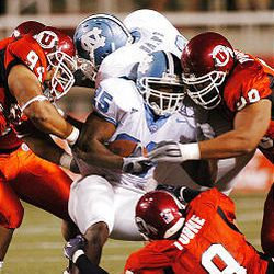 Ute defenders gang up on North Carolina's Ronnie McGill in first half Saturday. The Tar Heel offense struggled all night.