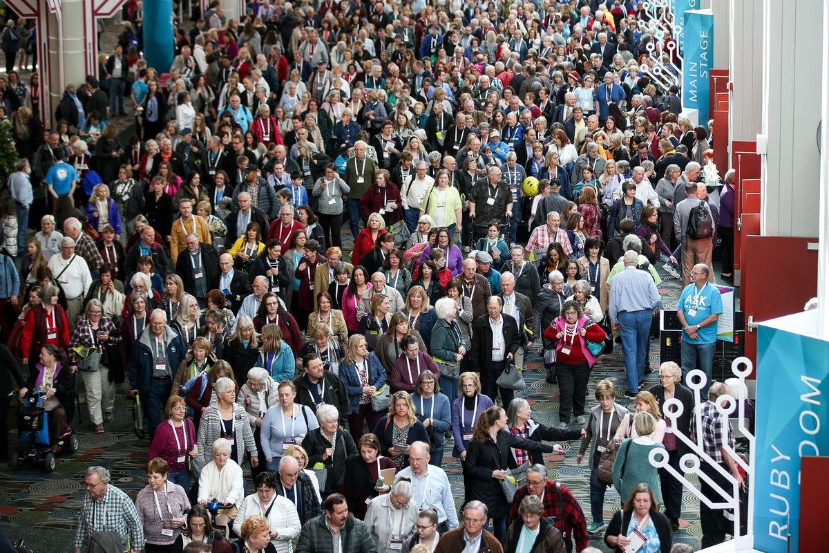 Attendees exit the Main Stage area after the keynote address at the 2019 RootsTech conference.