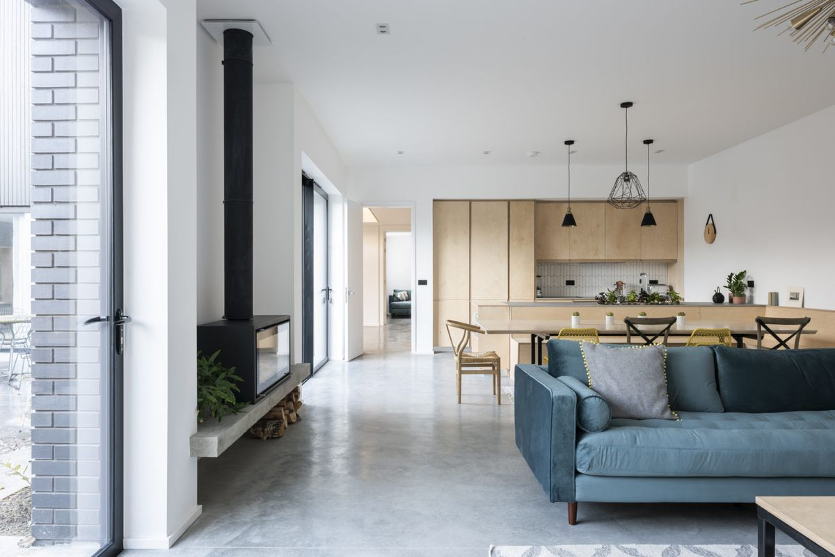 Living room with polished concrete floors and modern furniture.