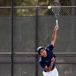 Waterford's Lalith Suresh serves against Rowland Hall's Jaiden Handlon in the 3A boys tennis No. 1 singles championship match at Liberty Park in Salt Lake City on Saturday, May 22, 2021.