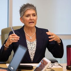 Kris Liacopoulos, general manager at Fidelity Investments in Salt Lake City, leads a center leadership meeting Tuesday, July 26, 2016.