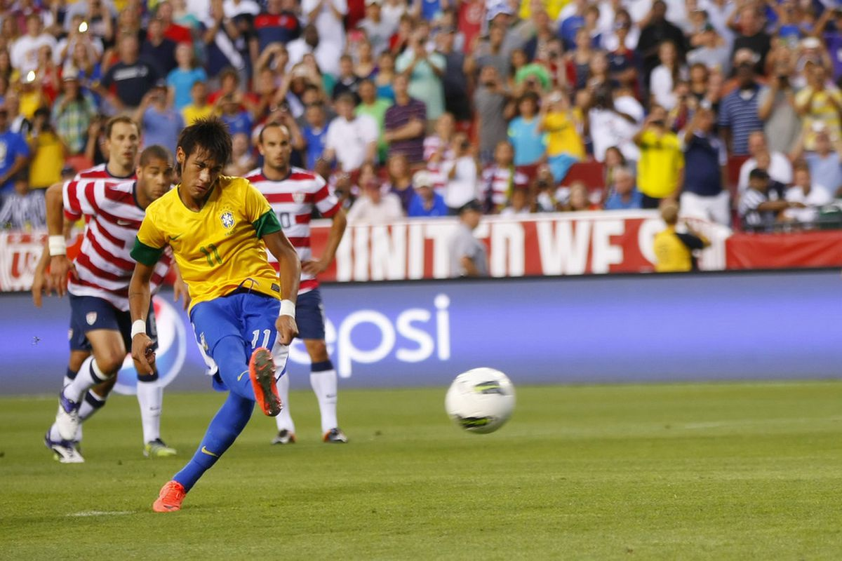May 30, 2012; Landover, MD, USA; Brazil forward Neymar (11) scores a goal on a penalty kick against the USA in the first half at FedEx Field. Mandatory Credit: Geoff Burke-US PRESSWIRE