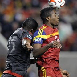 Real Salt Lake forward Olmes Garcia (13) heads the ball in front of Toronto FC defender Doneil Henry (15) during a game at Rio Tinto Stadium in Sandy on Saturday, March 29, 2014.