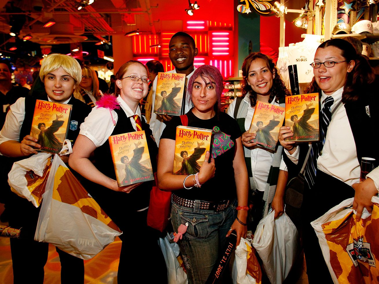 Harry Potter fans hold copies of Harry Potter and the Deathly Hallows during a release event in 2007.