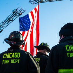 Chicago Fire Department sets up an American Flag to be draped outside the Cook County Medical Examiners Office in perpetration for a procession for a off duty Chicago Police Officer who was fatally shot inside his car in the River North neighborhood, Saturday, March 23, 2019, in Chicago.   Tyler LaRiviere/Sun-Times