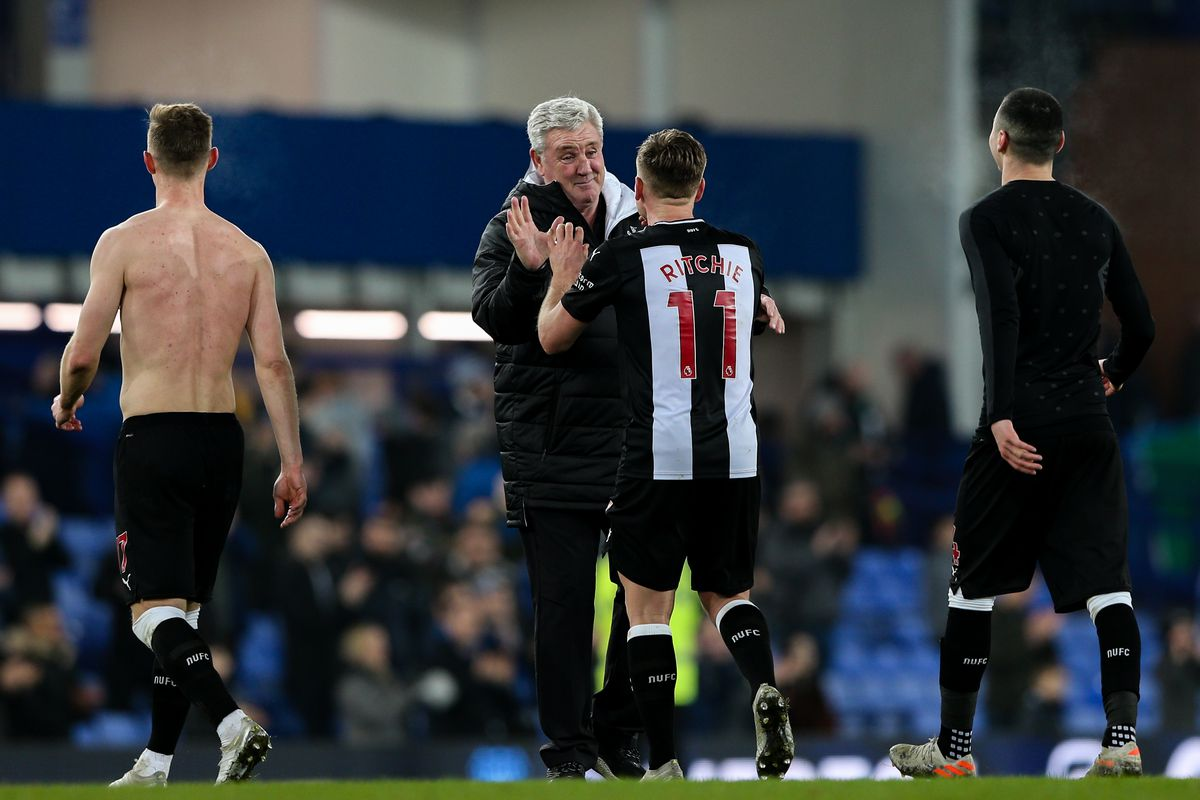 Matt Ritchie and Steve Bruce high fiving in congratulations at the end of a game
