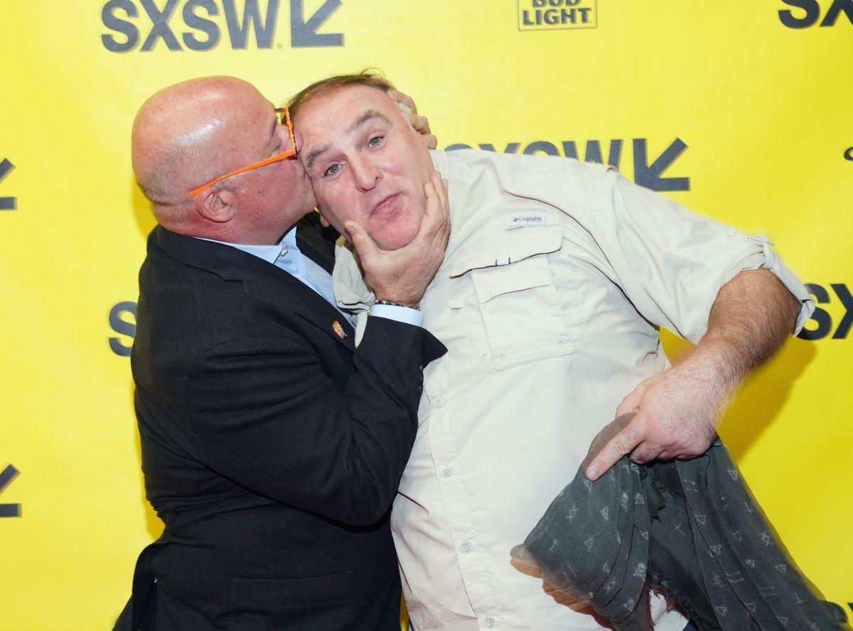 Andrew Zimmern kissing José Andrés at SXSW