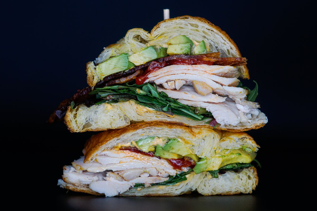 A sandwich with chicken, bacon, and avocado