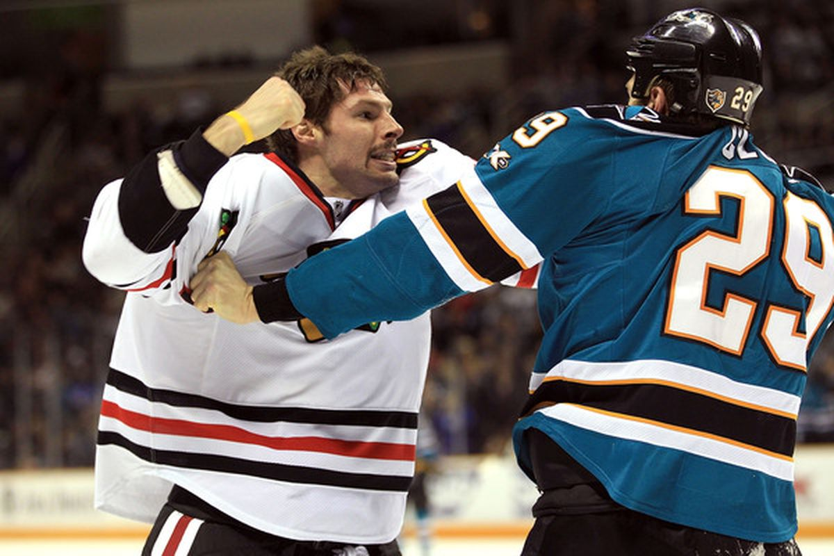 SAN JOSE CA - NOVEMBER 24:  Troy Brouwer #22 of the Chicago Blackhawks fights with Ryane Clowe #29 of the San Jose Sharks at HP Pavilion on November 24 2010 in San Jose California.  (Photo by Ezra Shaw/Getty Images)