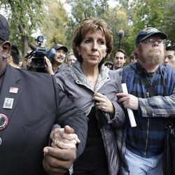 FILE - This Nov. 21, 2011 file photo shows University of California, Davis Chancellor Linda Katehi, center,  as she is escorted from the stage after she spoke during a rally on campus in Davis, Calif., after police pepper-sprayed peaceful demonstrators during a protest near the same spot. A University of California task force said Wednesday that UC Davis police should not have used pepper-spray on student demonstrators in an incident that prompted national outrage and calls for the chancellor's resignation. The task force also attributed the response to breakdowns in the campus chain of command, from Katehi to police Chief Annette Spicuzza to Lt. John Pike, the main officer shown in the widely viewed online videos.