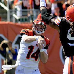 Cincinnati Bengals quarterback Andy Dalton (14) has a pass knocked down by Cleveland Browns defensive end Jabaal Sheard in the first half of an NFL football game, Sunday, Sept. 16, 2012, in Cincinnati.