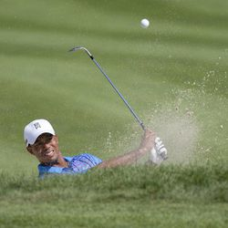 Tiger Woods hits out of the sand trap on the fourth hole during the second round of the Deutsche Bank Championship PGA golf tournament at TPC Boston in Norton, Mass., Saturday, Sept. 1, 2012.