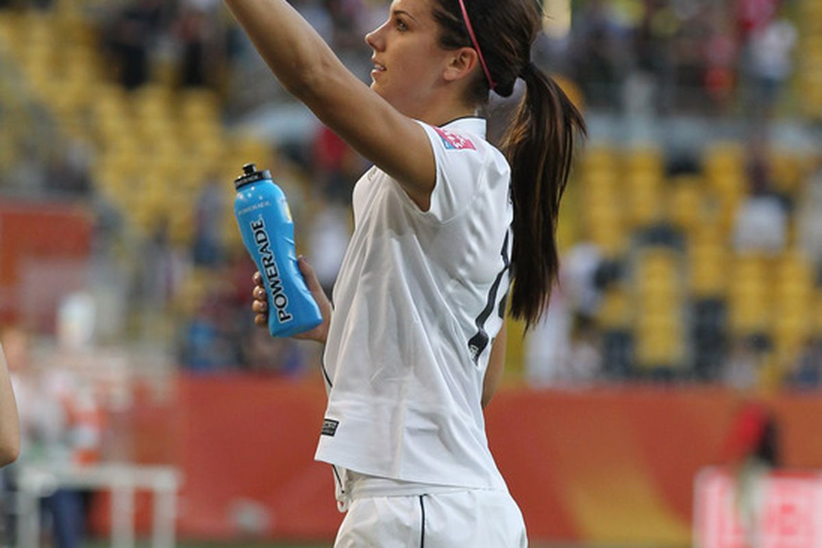 DRESDEN, GERMANY - JUNE 28: Alex Morgan of USA waves to her fans after winning the FIFA Women's World Cup Group C match between USA and Korea at Rudolf-Harbig-Stadion on June 28, 2011 in Dresden, Germany.  (Photo by Boris Streubel/Getty Images)