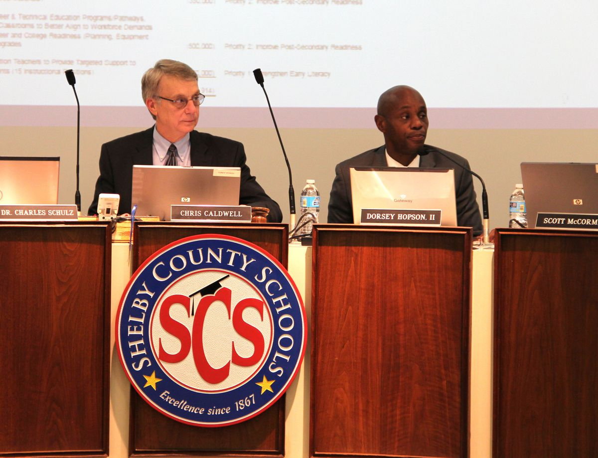 Board member Chris Caldwell and Superintendent Dorsey Hopson listen to a budget presentation in 2015.