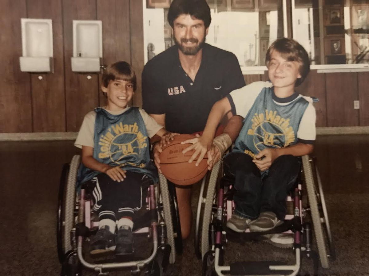 Coach Frank Burns with some of his students. He conducted wheelchair basketball tournaments throughout the United States as well as in Mexico, Canada, Japan, South Korea and Bahrain.