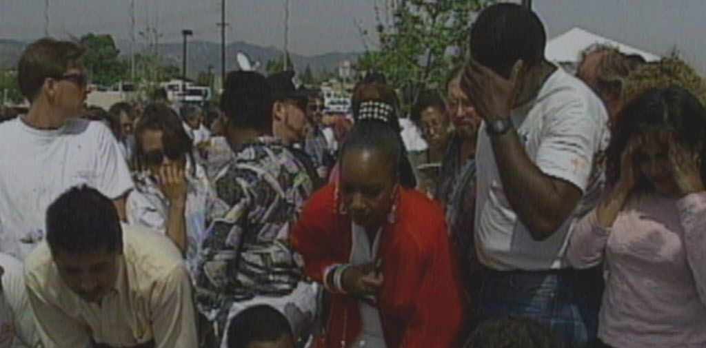 """Observers outside the Simi Valley Courthouse react to the Rodney King trial verdict in this scene from the documentary """"Let It Fall: Los Angeles 1982-1992,"""" directed by John Ridley.   LINCOLN SQUARE PRODUCTIONS"""