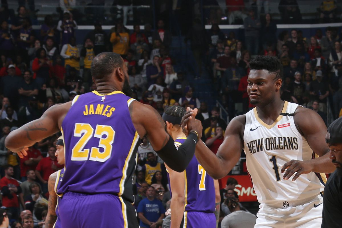 LeBron James of the Los Angeles Lakers and Zion Williamson of the New Orleans Pelicans high five before the game on March 1, 2020 at the Smoothie King Center in New Orleans, Louisiana.