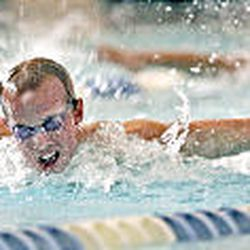 Kearns swimmer David Chandler competes in the boys' 100-yard butterfly in a meet against Riverton High.