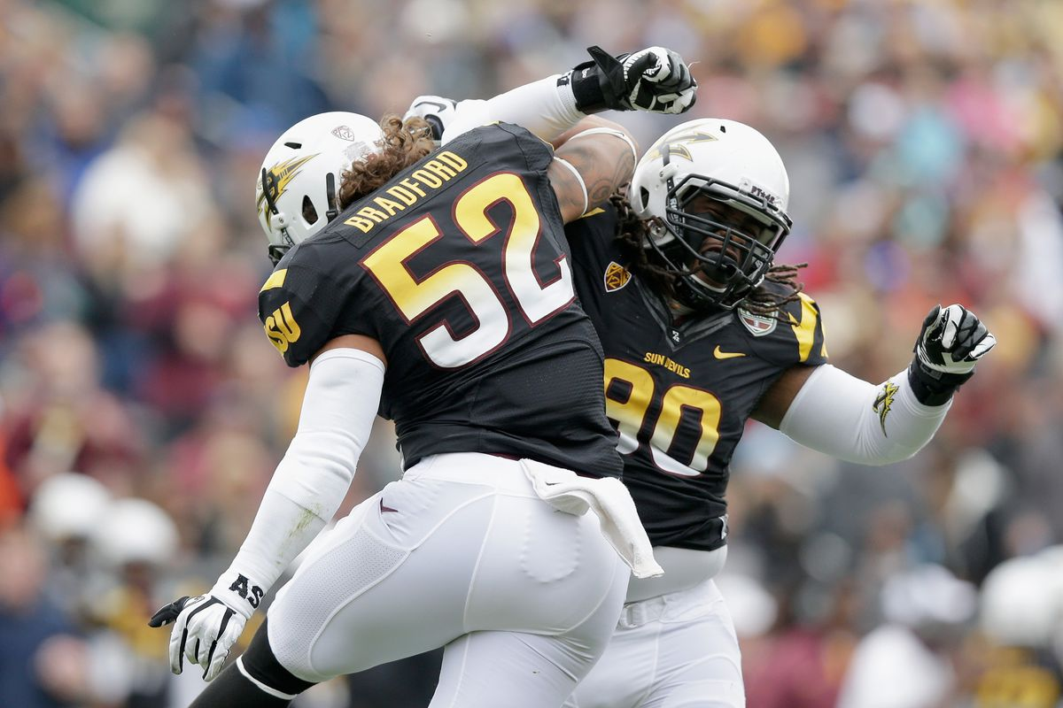 Will Sutton and Carl Bradford celebrate a near-penalty free effort in the Kraft Fight Hunger Bowl